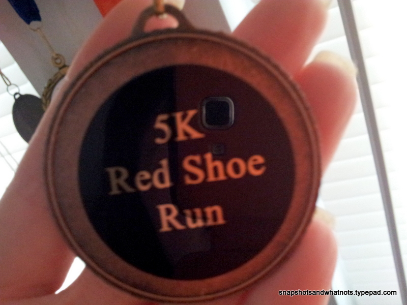 Winning a medal in my first 5k race (5)