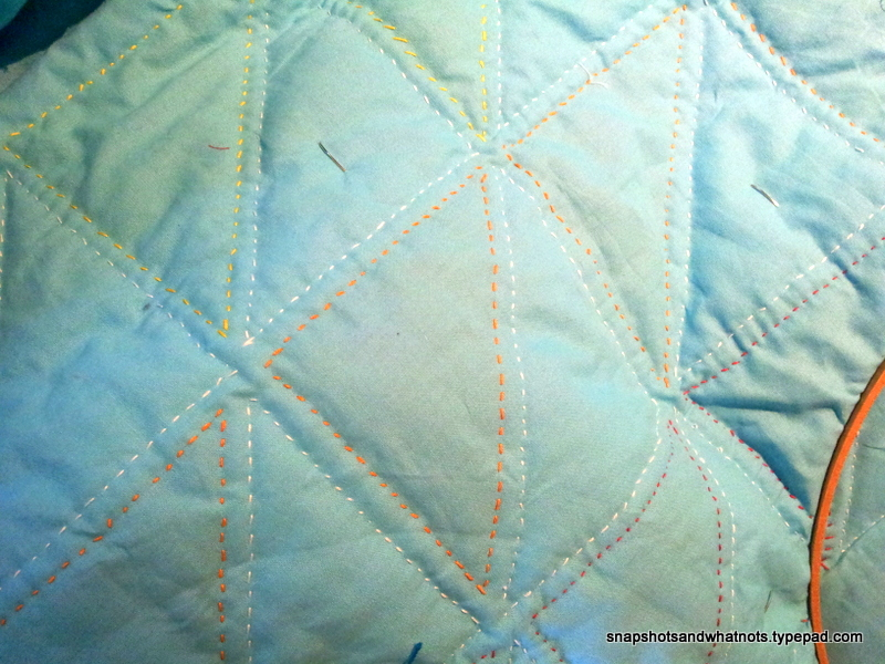 Hand-quilting on rainbow quilt (1)